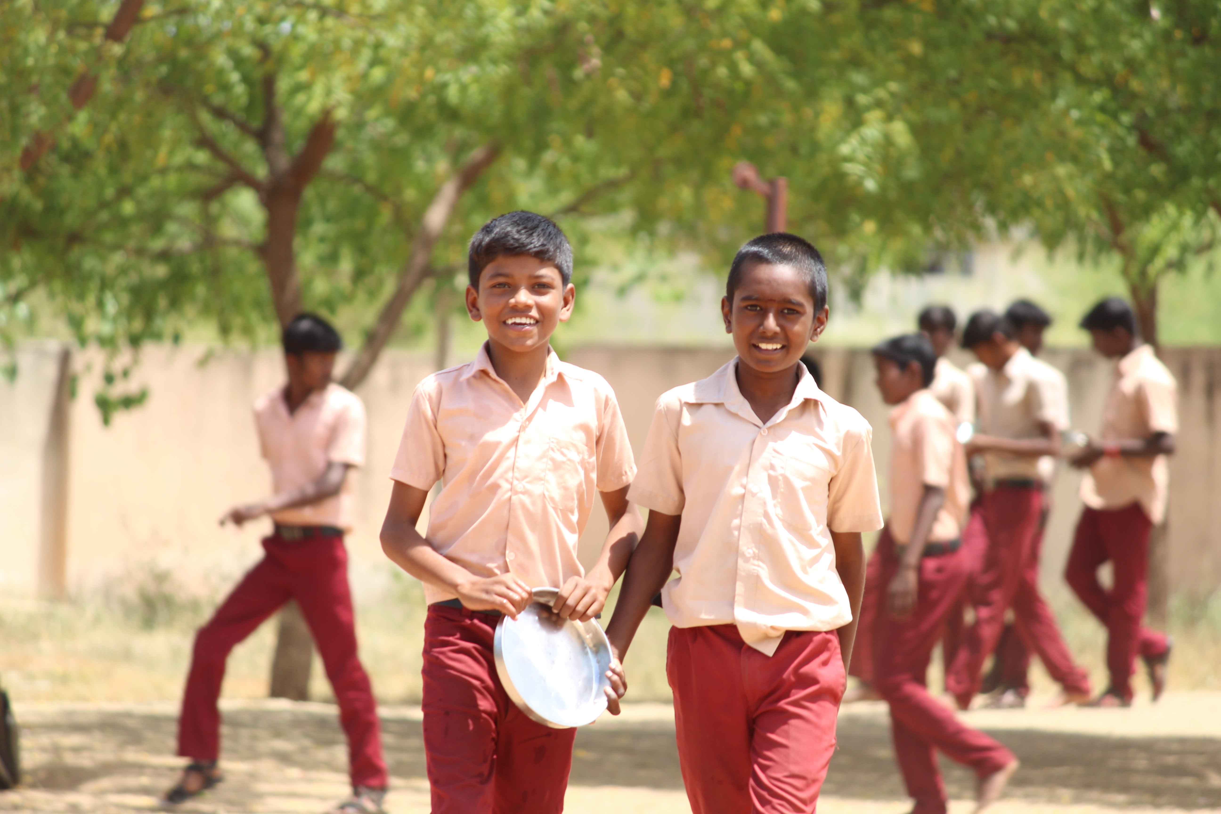 Two school students in India head to lunch break