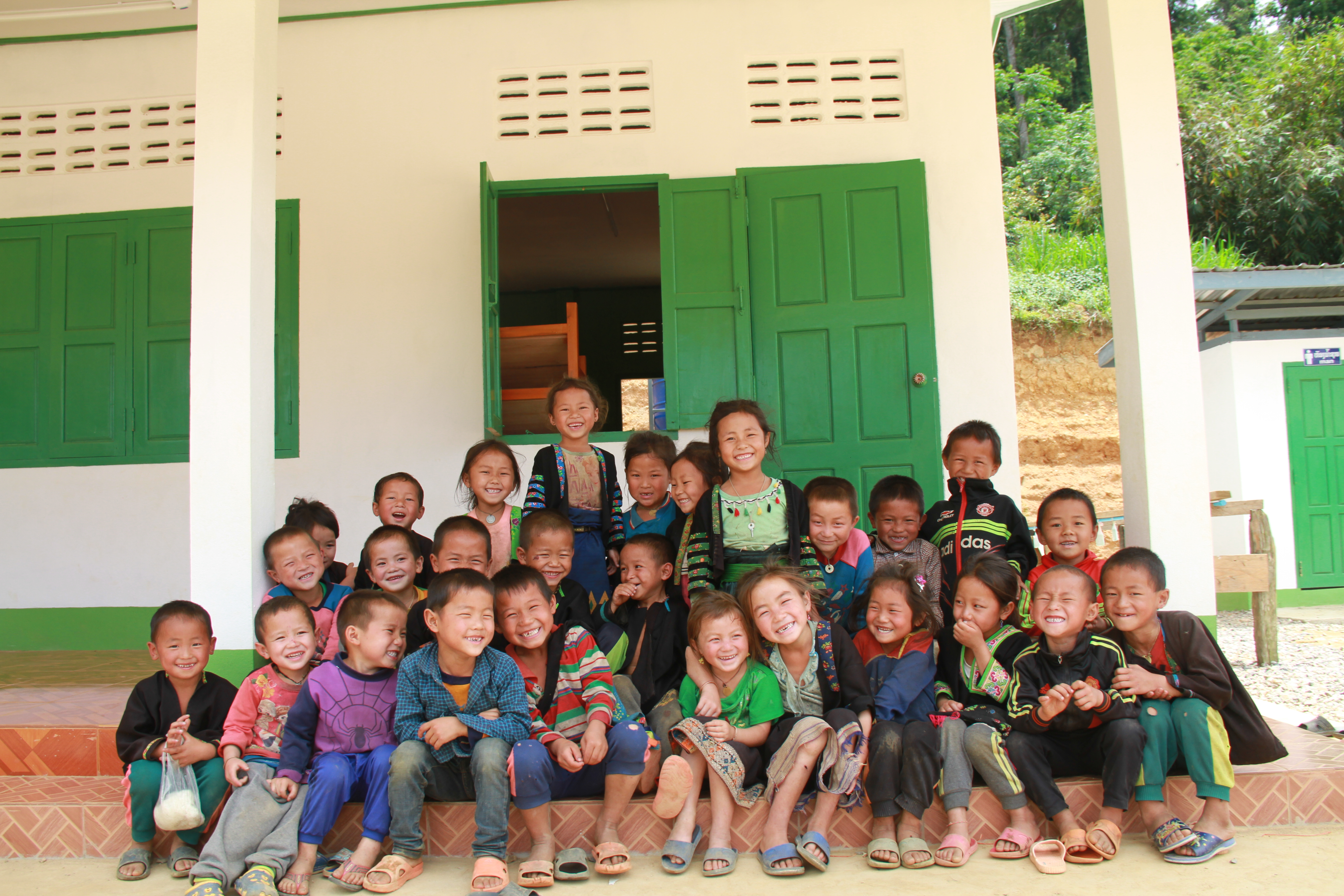 A group of children out the front of their classroom in Laos
