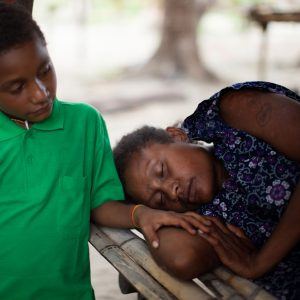 Child with his mother who is suffering from Tuberculosis in Papua New Guinea