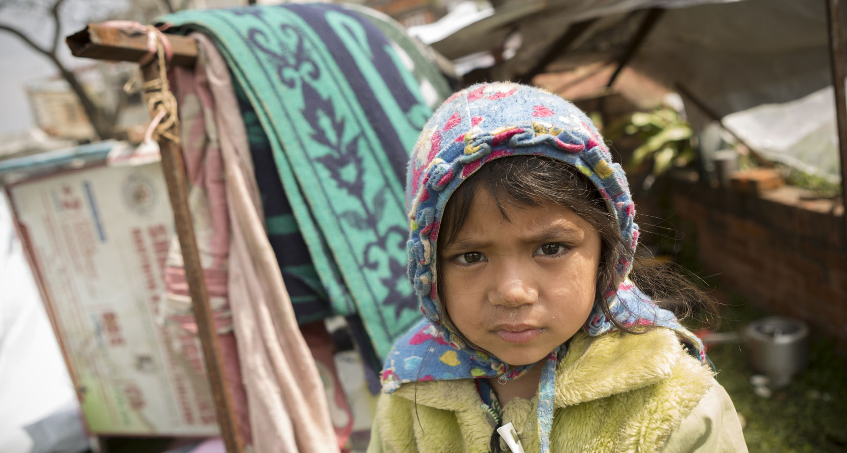 A young girl displaced in a camp after Nepal Earthquake