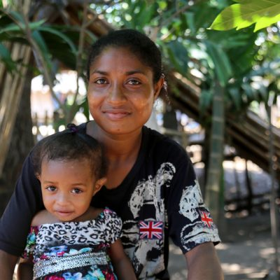Village Health Volunteer Patricia (right) helped Judy (left) get treatment when she had complications during the birth of her daughter Joylyn in Papua New Guinea.