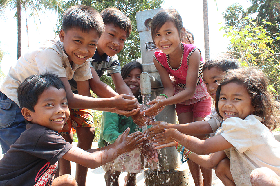 Children in Cambodia with a hand pump well