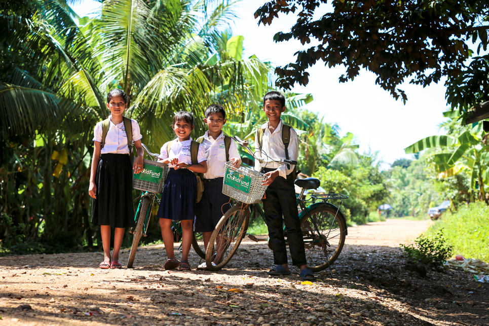 Schoolchildren with bikes in Cambodia