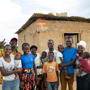 A family outside their home in rural Zambia