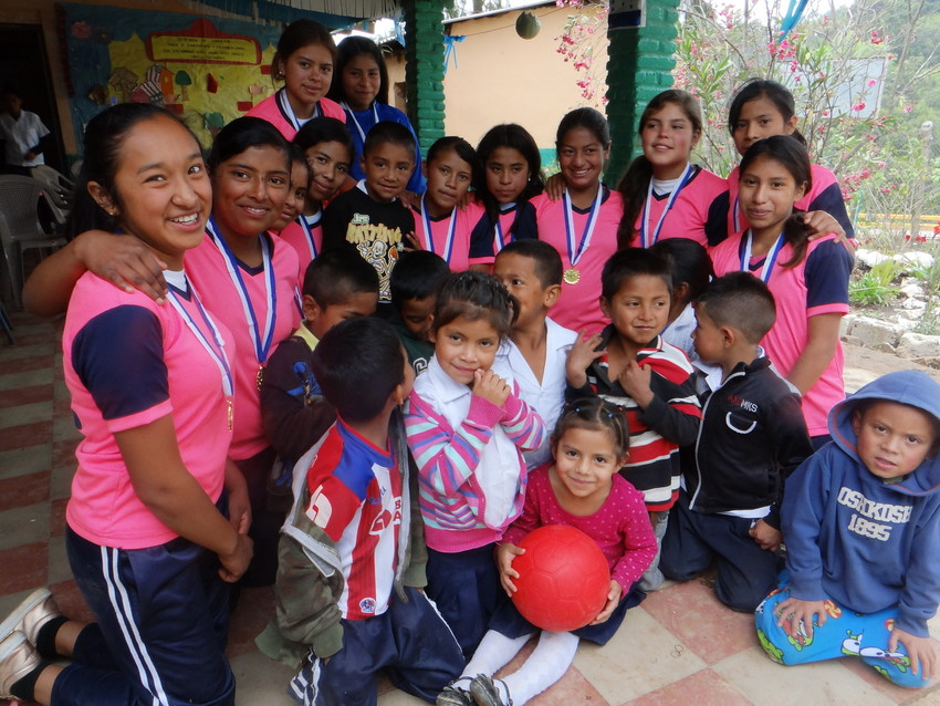 Kelin, 17 (second from left), is the captain of her school's girls' soccer team in rural Honduras. Before ChildFund donated unpoppable soccer balls to her school through One World Play Project's #PassTheHappiness campaign, she and her teammates used to have to borrow soccer balls from the boys just so they could play. Now, they're an award-winning girls' team in their area.