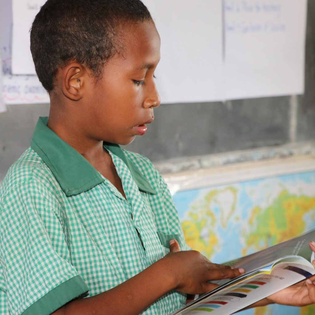 A student from Mr Solomon's class demonstrating his reading skills_compressed