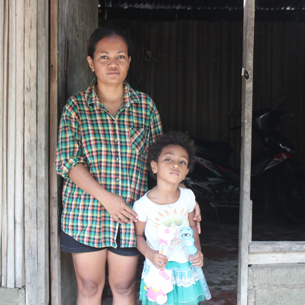 ChildFund Timor-Leste field staff Madalena and daughter Anisa, age 5.